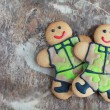 Постер, плакат: Two homemade Gingerbread men in protective khaki uniforms on Def