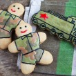 Homemade gingerbread old Soviet locomotive and soldiers in prote — Stock Photo #52624341