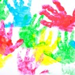 Multicolored painted hand prints on a white background — Stock Photo #52624493