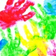 Multicolored painted hand prints on a white background — Stock Photo #52624497