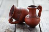 Still life with two old small jugs on a wooden table — Stock Photo