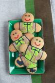 Gingerbread men in protective khaki uniforms on Defender of the  — Stock Photo