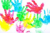 Multicolored painted hand prints on a white background — Stock Photo