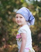 Little cute girl in a blue bandana, portrait, selective focus — Foto de Stock