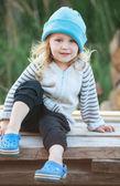 Little cute girl in a blue hat, portrait, selective focus — Foto de Stock