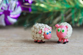 Plasticine world - little homemade white sheep with blue and gre — Stock Photo