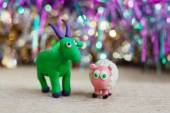 Plasticine world - little homemade green goat with purple horns — Stock Photo