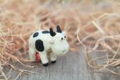 Plasticine world - little homemade black-and-white cow stands on — Stockfoto