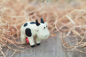 Plasticine world - little homemade black-and-white cow stands on — Stock fotografie