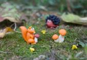 Plasticine world - little homemade squirrel with boletus sitting — Stock Photo