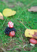Plasticine world - small homemade hedgehog with fly agaric found — Stock Photo