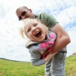 Dad playing with his baby daughter, he turns her around himself, — Stock Photo #57299251