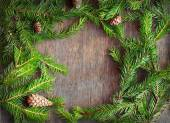 Christmas fir tree with cones on a wooden background, selective — Stock Photo