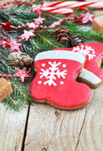 Homemade christmas gingerbreads painted as a red hat and boot of — Stock Photo