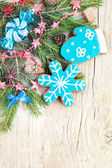 Homemade christmas gingerbreads painted as a blue snowflake and  — Stock Photo