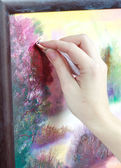 The artist paints a picture of the landscape using oily paints m — Stock Photo