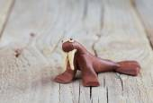 Plasticine world - little homemade brown walrus  on a wooden bac — Zdjęcie stockowe