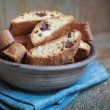 Homemade biscotti with chocolate and almonds in an old clay bowl — Stock Photo #67763975