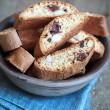 Homemade biscotti with chocolate and almonds in an old clay bowl — Stock Photo #67763977