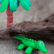 Plasticine world - little homemade green crocodile with palm tre — Stock Photo #67988269