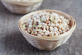 Green buckwheat sprouts in a bowl, close up, selective focus — Stock Photo