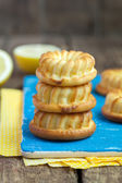 Homemade yellow lemon cakes on wooden table, selective focus — Stock Photo