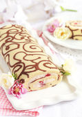 Homemade sponge roll with chocolate patterns, strawberries and Chiboust cream — Stock Photo