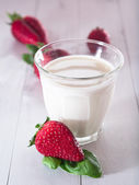 Strawberries with milk — Stock Photo