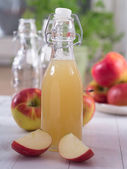 Apple juice in a bottle — Stock Photo