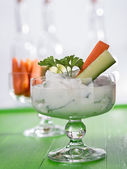 Curd for dipping with carrots and cucumber — Stock Photo