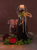 Beetroot in the glass and beetroot juice in a bottle — Stock Photo