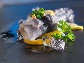 Rollmop herring on lemon slices — Stock Photo