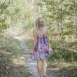 Barefoot woman walking through the forest. — Stock Photo #53753659
