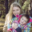 Mum with a daughter in autumn forest. — Stock Photo #56624783