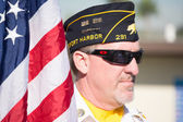 An unidentified  veteran with American flag — Stock Photo