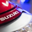 Постер, плакат: Close up of Suzuki logo motorcycle