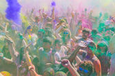 People celebrating during the color throw. — Stock Photo