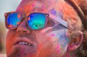 Unknown man with painted face and glasses looking at the stage — Stock Photo