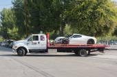 Ferrari 458 broken on tow truck — Stock Photo