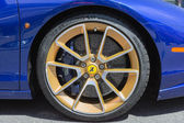 Ferrari wheels on display — Stock Photo