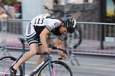 Blur of cyclist in motion — Stock Photo