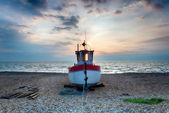 Fishing Boat on a Shingle Beach — Stock Photo