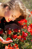 Young beautiful girl in the poppy  field — Stock Photo
