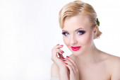 Beautiful bride with fashion hairstyle and make-up on white back — Stock Photo