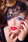Beautiful Woman with Black Lace mask over her Eyes — Stock Photo