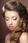 Portrait of the beautiful young girl in an image of the bride wi — Stock Photo