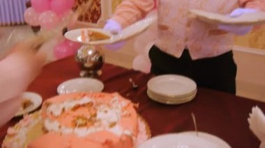 Waiters are laid out pieces of cake on plates — Stock Video