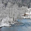 Winter landscape with a blue river — Stock Photo #61178663