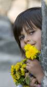 Happy girl with yellow flowers — Photo