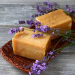 Bars of soap and lavender flowers — Stock Photo